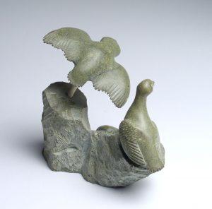 TWO BIRDS ON ROCK